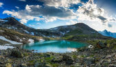 Alpine lake with last snow in summer — Stock Photo