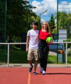 Teenagers on sports ground — Стоковое фото