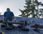 Workers reapiring roof — Stock Photo