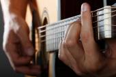 Guitarist performing song — Stock Photo