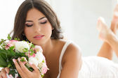Beautiful bride holding nuptial bouquet — Photo