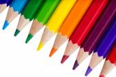 Row of colourful pencils isolated over white background — Stock Photo