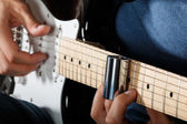 Electric guitar player performing song — Foto Stock