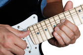 Hands of man playing electric guitar — Stock Photo