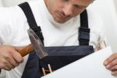 Man putting together self assembly furniture — Stock Photo