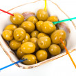 Yellow, green olives in plate with canape sticks — Stock Photo #70653119