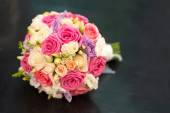 Wedding saturate pink rose bouquet of bride on black — Stock Photo