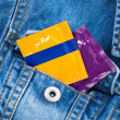 Condom in the pocket of blue jeans jacket — Stock Photo #70670727