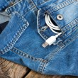White USB cable in jeans pocket, USB cord with the jeans pocket  — Стоковое фото #70670803