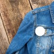 White round badge button on denim jacket — Stock Photo #70671103