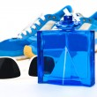 Bottle spray of sports men perfume, sneakers, sunglasses on whit — Stock Photo #70673591