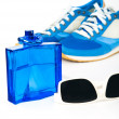 Bottle spray of sports men perfume, sneakers, sunglasses on whit — Stock Photo #70673593