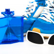 Bottle spray of sports men perfume, sneakers, sunglasses on whit — Stock Photo #70673611