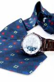 Classic business watches and abstract blue necktie isolated on w — Stock Photo