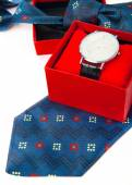Classic business watches in red box and abstract blue necktie is — Zdjęcie stockowe
