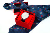 Classic business watches in red box and abstract blue necktie is — Foto Stock