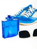 Bottle spray of sports men perfume, sneakers, sunglasses on whit — Stock Photo