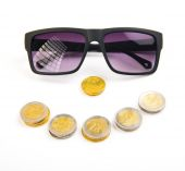 Money and success concept. Black sunglasses with smile face from — Stock Photo