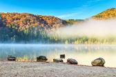 Beautiful foggy autumn landscape,Saint Anna Lake,Transylvania,Romania — Stockfoto