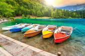 Wonderful alpine landscape and colorful boats,Lake Fusine,Italy,Europe — Stock Photo