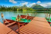 Colorful wooden boats on the alpine lake,Strbske Pleso,Slovakia — Stock Photo