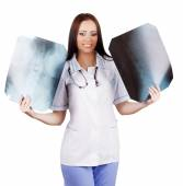 Woman doctor with x-rays in hand — Stock Photo