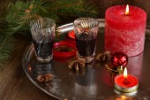 Christmas background with liquor, spices, candles and fir branches — Foto de Stock