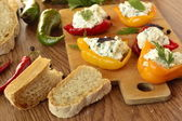 Baked paprika stuffed with cottage cheese with herbs — Stock Photo