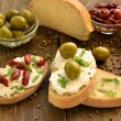 Sandwich with cottage cheese olives and sun-dried tomatoes — Stock Photo #68751725