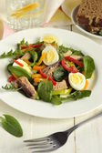 Fish salad with quail eggs, sweet peppers, herbs — Stock Photo