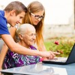 Grandson Helping Grandmother with Modern Technology — Stock Photo #56414151