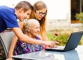 Grandson Helping Grandmother with Modern Technology — Stock Photo