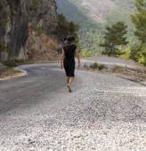Man and woman hikers trekking roads in Turkey — Stock Photo