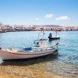 Boat with city of Mykonos, Greece. — Stock Photo #66642581