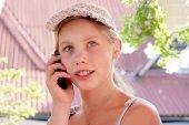 Happy teenage girl talks on phone — Stock Photo