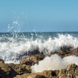 Piece of sea foam against waves — Stock Photo #70716549