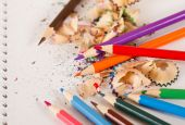 Color pencils and colorful pencil shavings — Stock Photo