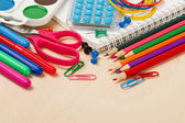 Colorful assortment of school supplies — Stock Photo
