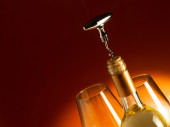 White wine bottle with corkscrew — Stock Photo