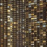 Modern high condominium at night time — Stock Photo #56047567