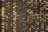 Modern high condominium at night time — Stock Photo