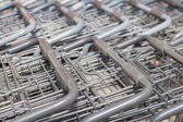 Rows of shopping carts — Stock Photo