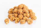 Almonds and caramal popcorn — Stock Photo