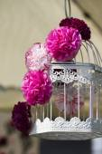 Handmade paper flowers on the cage — Stock Photo