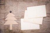 Christmas tree and old postcards — Stock Photo