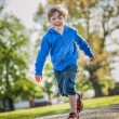 Happy Boy Running in the Park — Stock Photo