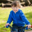 Happy Boy on his BIke in the Park — Stock Photo #51805863