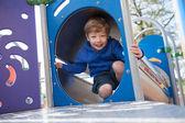 Happy Boy on Playground Equipment — Stock Photo
