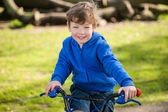 Happy Boy on his BIke in the Park — Stock Photo