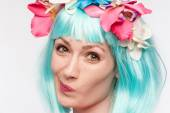 Twisted Face Girl Turquoise Wig Flowers — Stock Photo